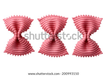 Food: red beetroot uncooked farfalle pasta, isolated on white background - stock photo