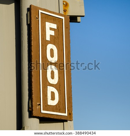 Food sign with a blue sky on background - stock photo