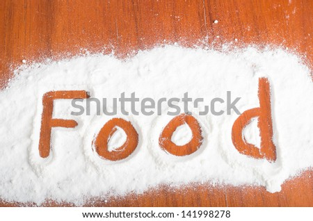 food sign with flour Artwork With Food And Handprints, Fun background with human handpints in scattered flour on a wooden tabletop.
