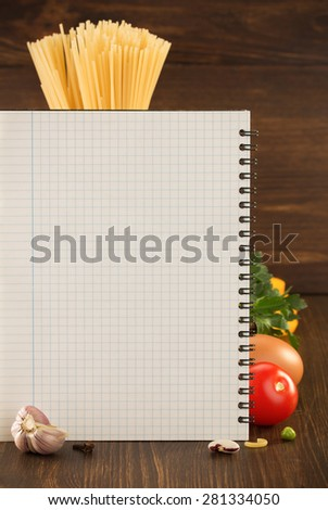food spice and cookbook on wooden background