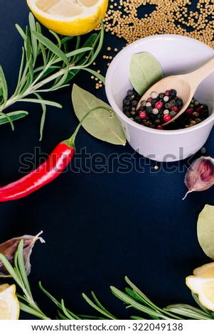 Food spice seasoning ingredients for cooking in cuisine on dark background. Dry powder curry, ginger, cardamon, rosemary, chili. Asian  yellow, green colorful aroma condiment.   - stock photo