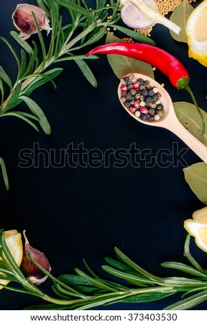Food spice seasoning ingredients for cooking in cuisine on dark background in the wooden spoon. Dry powder curry, ginger, cardamon, chili, laurel, garlic. Asian  yellow, green aroma condiment.   - stock photo
