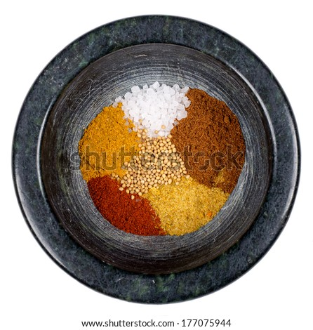 food spices in mortar isolated on white background  - stock photo