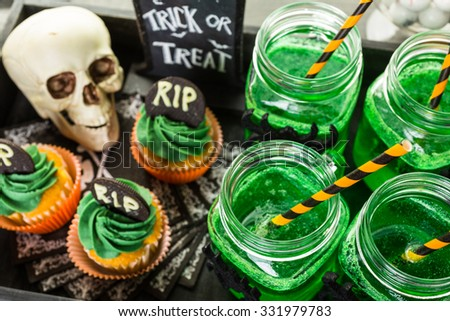 Food table arrangement prepared for Halloween party.