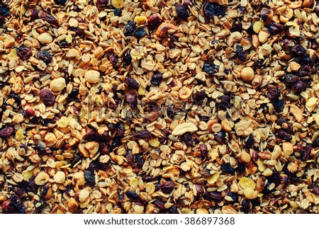 Food Texture Muesli Dry Fruits Nuts Oats Raisin Cereals Flakes Background Toned - stock photo