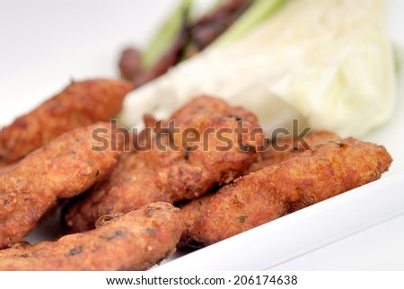 food,Thai Food Fish Cake (Tod Mun Pla),Fish cakes , thai cuisine,grilled french cutlets served on basil leafs,fried meatballs with herbs on white background - stock photo