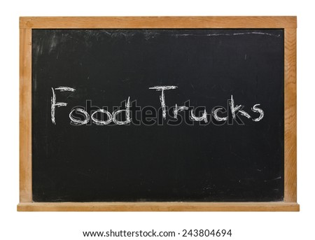 Food Trucks written in white chalk on a wood framed black chalkboard isolated on white - stock photo