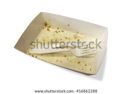 Food waste on paper plates with plastic knives and forks isolated white background. The file includes a clipping path so it is easy to work. - stock photo