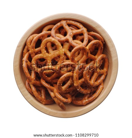 Food: wooden bowl full of salted pretzels, isolated on white background
