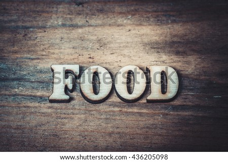 Food word abstract. Text in vintage letters wood type. Healthy eating and lifestyle concept. Toned photo. - stock photo
