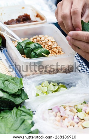 Food wrapped in leaves or Miang Kham sold as local market, Thailand-7 - stock photo