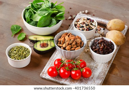Foods containing potassium on a wooden table.  - stock photo