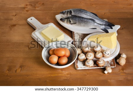 Foods containing vitamin D on a wooden table. View from above - stock photo