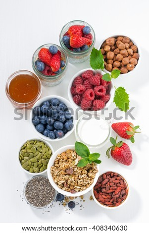 foods for healthy nutrition and breakfast on white table, top view, vertical - stock photo