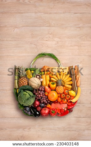 Foods made handbag / food photo of designer handbag made from different fruits and vegetables on wooden table  - stock photo