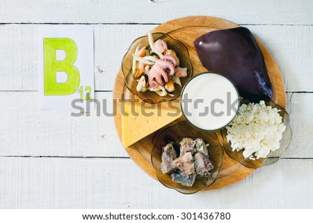 Foods that contain vitamin B 12: seafood, liver, milk, cheese, cottage cheese, sardines in oil - stock photo