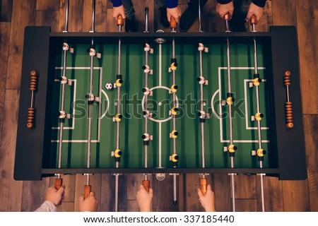 foosball game top view of foosball table on the wooden floor