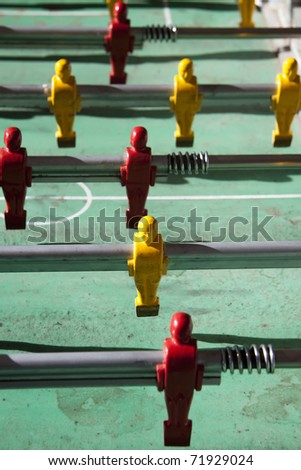 foosball game with strong sunlight - stock photo