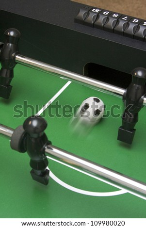 Foosball shot going into the opponent's goal - stock photo