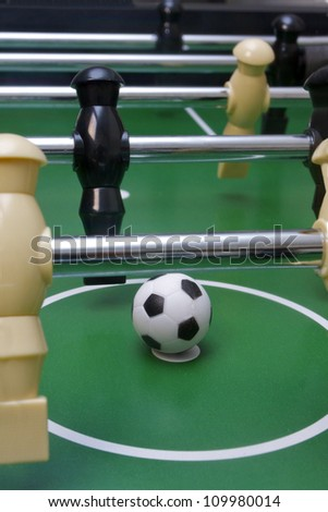Foosball soccer pieces on the game table - stock photo