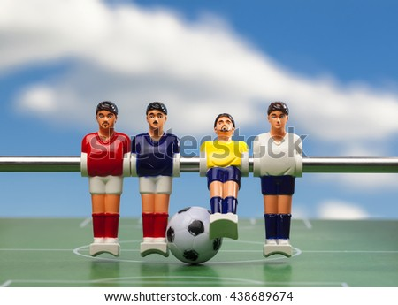 foosball table soccer .sport time football players - stock photo