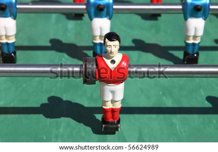 foosball. vintage metal table soccer players - stock photo