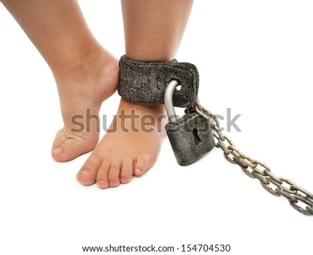 Foot a little boy in chains - stock photo