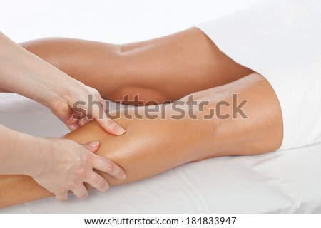 Foot and legs massage, alternative therapy, studio shot
