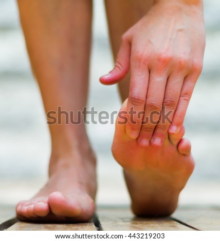 Foot are important to be healthy, massage foot on the tiptoe. Wooden floor