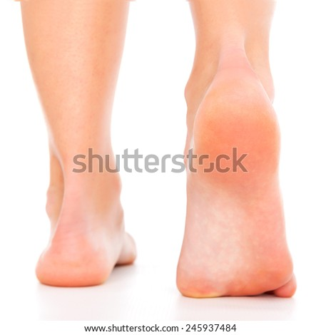 Foot care from back - stock photo