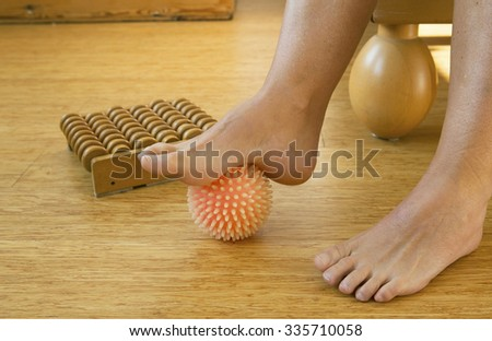 foot in with rubber massage ball - stock photo