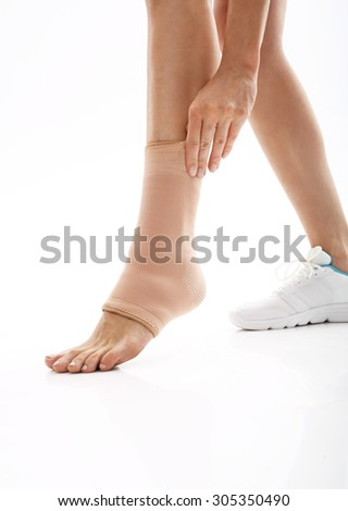 Foot injury, stabilizer ankle. Foot injury, compression bandage - stock photo