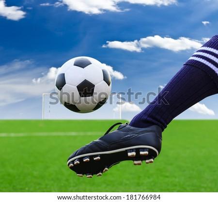 foot kicking soccer ball - stock photo