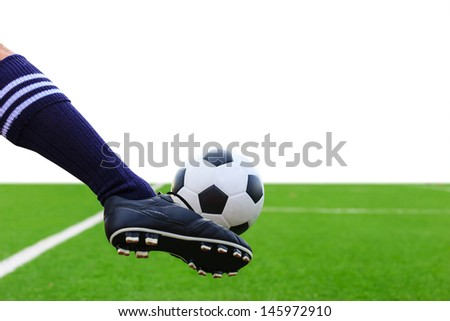 foot kicking soccer ball isolated with clipping path - stock photo