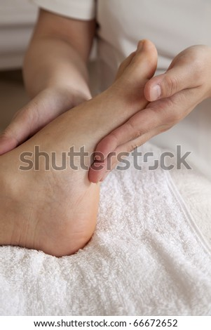 foot massage in a professional massage clinic - stock photo