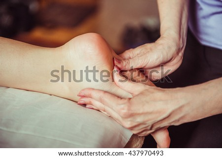 foot massage. massage of the feet in the spa salon