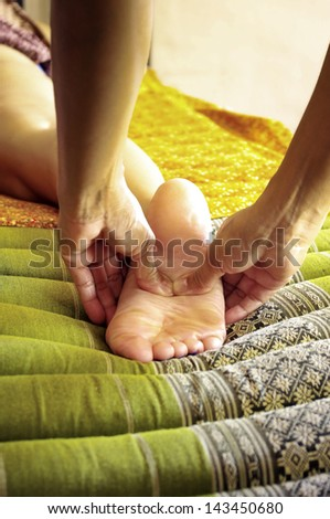 Foot massage, Reflexology concept - stock photo