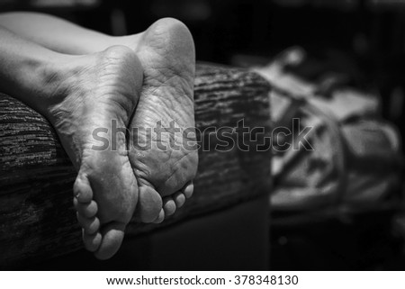 Foot of human on the bed with dark tone