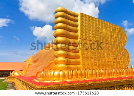 Foot of Reclining buddha at thailand. Generality in Thailand, This photo is public domain or treasure of Buddhism, no restrict in copy or use. No any trademark or restrict matter in this photo. - stock photo