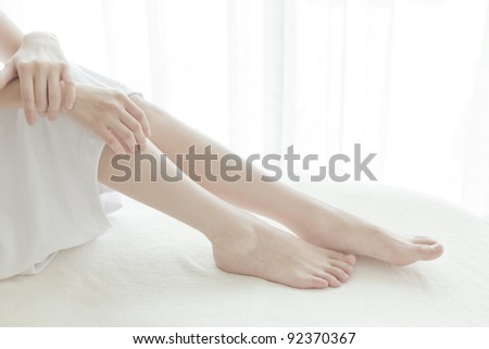 Foot of the woman on the massage bed
