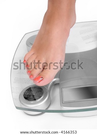 Foot on a bathroom scale - Isolated - stock photo