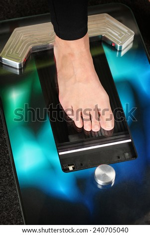 Foot on a 3D foot scanner for orthotics - stock photo
