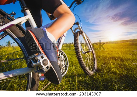 foot on pedal of bicycle. active summer