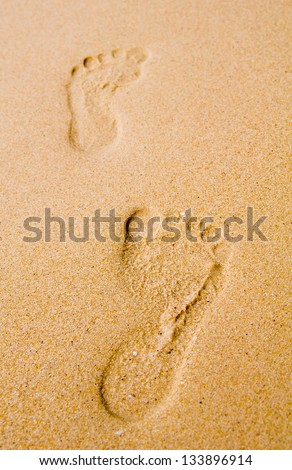 Foot on sand texture background