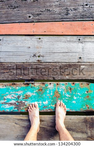 Foot on the vintage wooden floor - stock photo