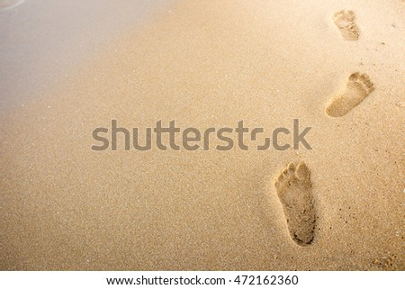 Foot print on sand at beach