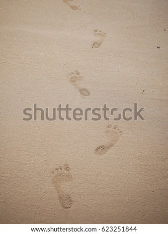 Foot print on sand beach