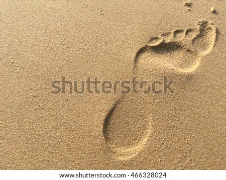 foot print on sand beach travel concept