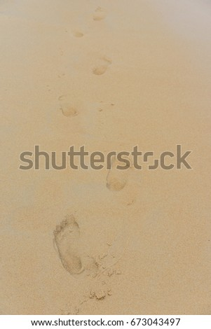 Foot print on the beach at Phuket, Thailand.