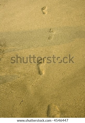 foot prints at the beach - stock photo